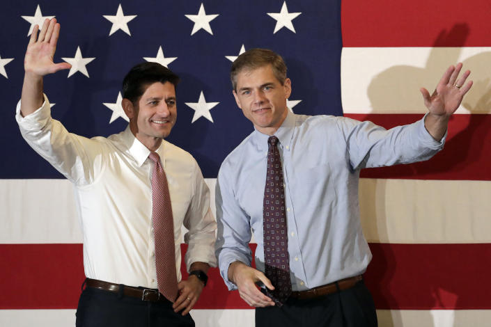 Paul Ryan, left, and Jay Webber greet supporters during a campaign event on Wednesday, Oct. 17, 2018, in Hanover, N.J. (Photo: Julio Cortez/AP)