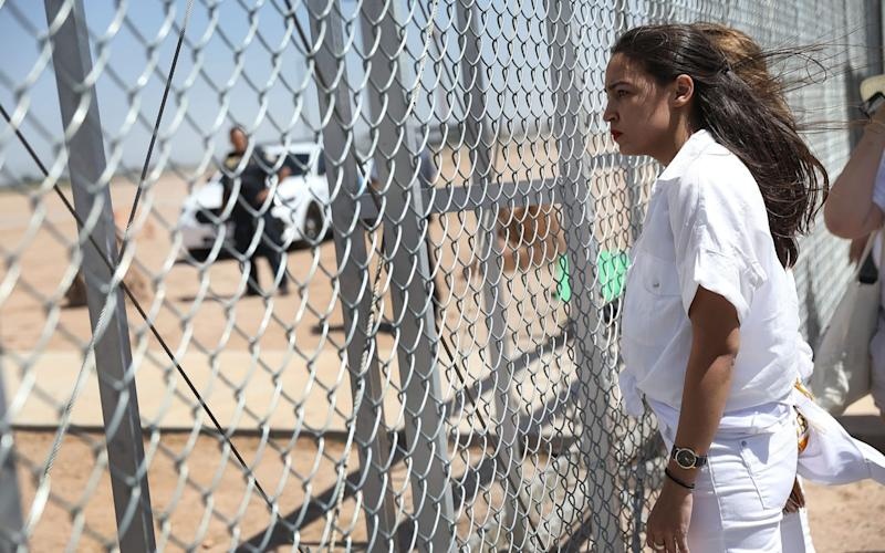 Alexandria Ocasio-Cortez protesting the separation of children from their parents last week - Getty Images North America