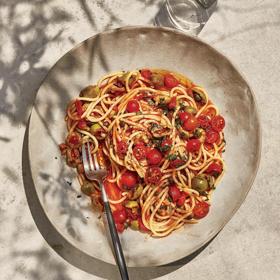 "Tomato seeds and membranes can be a bit bitter, which is why we remove them from this uncooked preparation—it also prevents the sauce from being watery. <a href=""https://www.bonappetit.com/recipe/spaghetti-with-no-cook-puttanesca?mbid=synd_yahoo_rss"" rel=""nofollow noopener"" target=""_blank"" data-ylk=""slk:See recipe."" class=""link rapid-noclick-resp"">See recipe.</a>"