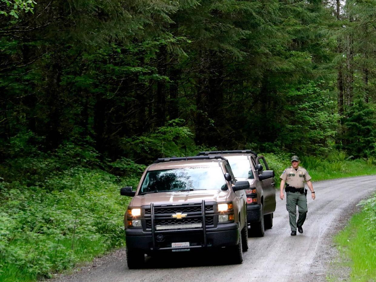 Police on the scene of the attack in North Bend, near Seattle (AP)