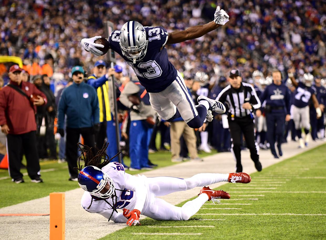 EAST RUTHERFORD, NEW JERSEY - NOVEMBER 04: Michael Gallup #13 of the Dallas Cowboys jumps over Janoris Jenkins #20 of the New York Giants for a touchdown in the fourth quarter of their game at MetLife Stadium on November 04, 2019 in East Rutherford, New Jersey. (Photo by Emilee Chinn/Getty Images)
