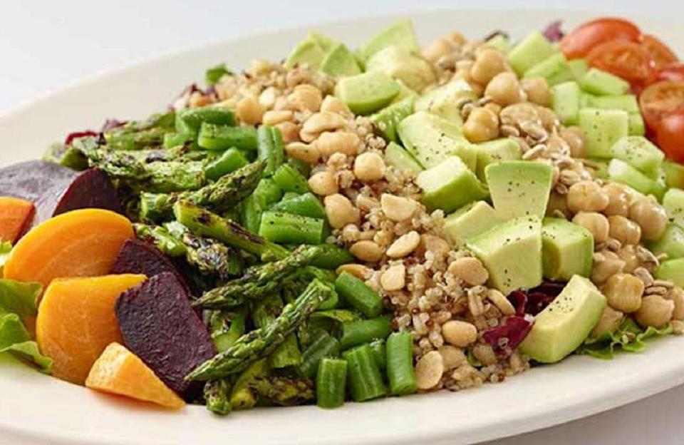 """<p>This cobb salad recipe is one of many <a href=""""https://www.thedailymeal.com/cook/7-easy-recipes-help-you-go-vegan-slideshow?referrer=yahoo&category=beauty_food&include_utm=1&utm_medium=referral&utm_source=yahoo&utm_campaign=feed"""" rel=""""nofollow noopener"""" target=""""_blank"""" data-ylk=""""slk:vegan recipes that will make you want to go plant-based"""" class=""""link rapid-noclick-resp"""">vegan recipes that will make you want to go plant-based</a>. Forego the hard-boiled eggs and use garbanzo beans as your source of protein.</p> <p><a href=""""https://www.thedailymeal.com/recipes/cheesecake-factorys-vegan-cobb-salad-recipe?referrer=yahoo&category=beauty_food&include_utm=1&utm_medium=referral&utm_source=yahoo&utm_campaign=feed"""" rel=""""nofollow noopener"""" target=""""_blank"""" data-ylk=""""slk:For the Vegan Cobb Salad recipe, click here."""" class=""""link rapid-noclick-resp"""">For the Vegan Cobb Salad recipe, click here.</a></p>"""