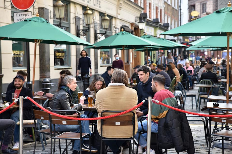 LONDON, UNITED KINGDOM - APRIL 18, 2021 - Alfresco dining in Old Compton Street, Soho as the lockdown eases. (Photo credit should read Matthew Chattle/Barcroft Media via Getty Images)