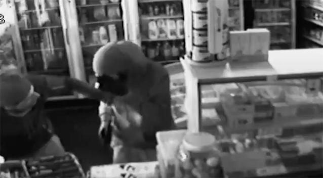 He was given a hand before jumping over the counter. Source: Victoria Police