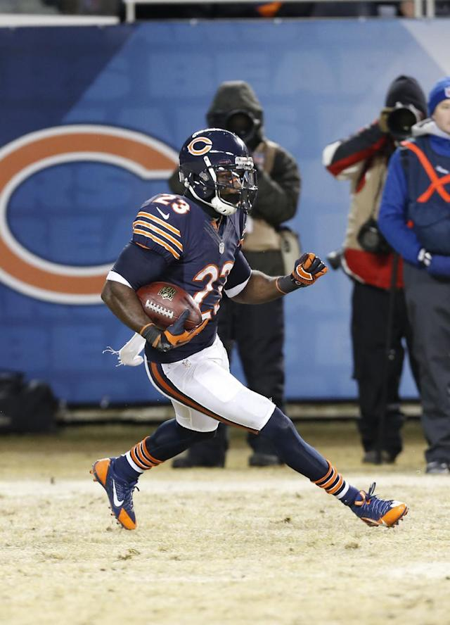 Chicago Bears wide receiver Devin Hester (23) runs on a kick off return during the first half of an NFL football game against the Green Bay Packers, Sunday, Dec. 29, 2013, in Chicago. (AP Photo/Charles Rex Arbogast)