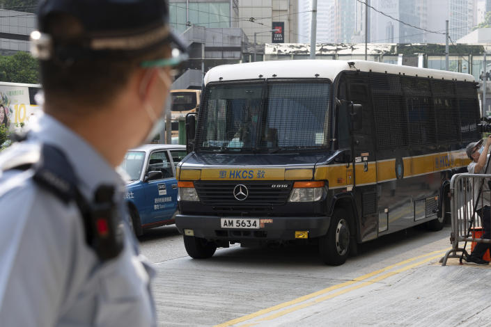 A prison van which a police officer says is carrying Tong Ying-kit arrives at a court in Hong Kong Tuesday, July 27, 2021. Tong, 24, the first person to be tried under Hong Kong's sweeping national security law was found guilty of secessionism and terrorism on Tuesday in a ruling condemned by human rights activists. (AP Photo/Matthew Cheng)