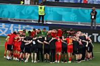 Wales players gather in a huddle after securing a place in the last 16 of Euro 2020 despite losing to Italy in Rome