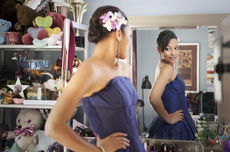 "This image courtesy of Disney Enterprises, Inc. shows Kylie Bunbury  during a scene from the Disney film ""Prom.""  Prom-dress trends come and go _ bright colors and bohemian looks this season _ but the fashion personalities of the high-school girls celebrating the end of the school year in probably the fanciest dress they've ever worn are consistent: Every ballroom has its princess, glamour puss, trendsetter and rebel.  (AP Photo/Disney Enterprises, Inc., Richard Foreman Jr.)"