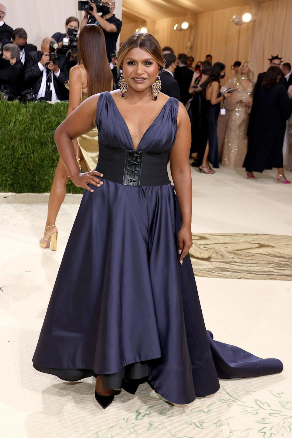 """<h1 class=""""title"""">Mindy Kaling in Tory Burch and Jimmy Choo shoes</h1><cite class=""""credit"""">Photo: Getty Images</cite>"""