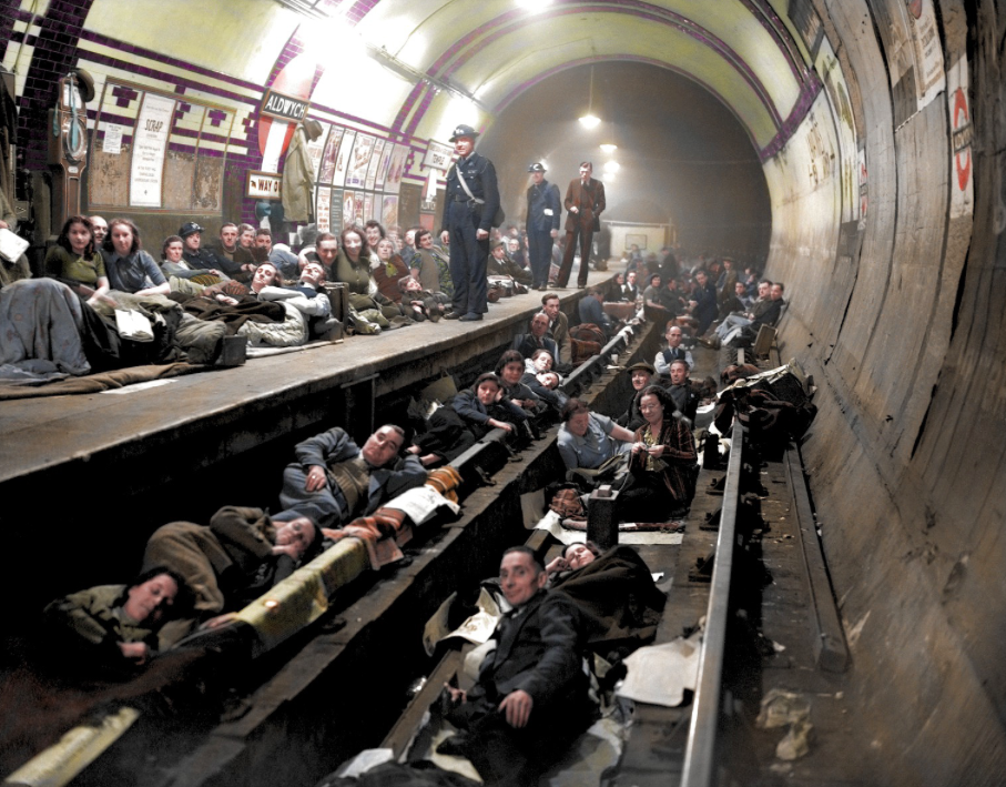 <p>Londoners lie on the tracks at Aldwych Underground Station to shelter from the aerial bombardment. (MediaDrumWorld) </p>