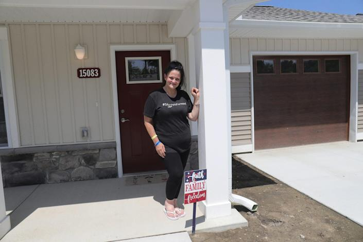 Monica Meldrum in front of her new home in Eastpointe July 26, 2021.