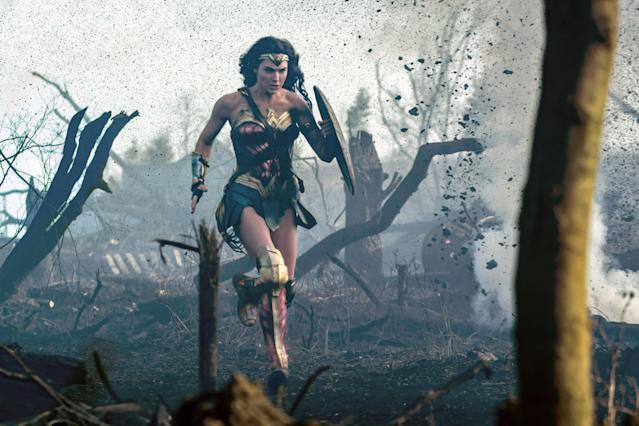 "<p>As Marvel continues to make excuses as to why there are no plans for a Black Widow movie (and only announced Brie Larson as Captain Marvel in 2016), DC burst out of the gate with <em>Wonder Woman</em>, featuring Gal Gadot in the star-making role and director Patty Jenkins leading the film to box office and critical success. It became the third-highest-grossing domestic release for Warner Bros. and the <a href=""https://www.yahoo.com/entertainment/wonder-woman-crosses-400-million-domestic-box-office-160055626.html"" data-ylk=""slk:highest-grossing film;outcm:mb_qualified_link;_E:mb_qualified_link"" class=""link rapid-noclick-resp newsroom-embed-article"">highest-grossing film</a> for a female director, it inspired the <a href=""https://www.yahoo.com/entertainment/wonder-woman-pennywise-top-movie-inspired-halloween-costumes-2017-134705595.html"" data-ylk=""slk:most popular Halloween costume;outcm:mb_qualified_link;_E:mb_qualified_link"" class=""link rapid-noclick-resp newsroom-embed-article"">most popular Halloween costume</a> alongside Pennywise the Clown, and it became 2017's <a href=""https://www.yahoo.com/entertainment/wonder-woman-2017-most-tweeted-movie-161237052.html"" data-ylk=""slk:most tweeted-about movie;outcm:mb_qualified_link;_E:mb_qualified_link"" class=""link rapid-noclick-resp newsroom-embed-article"">most tweeted-about movie</a> as well as one of <a href=""https://www.yahoo.com/entertainment/afi-top-10-movies-2017-213146967.html"" data-ylk=""slk:AFI's top 10 films;outcm:mb_qualified_link;_E:mb_qualified_link"" class=""link rapid-noclick-resp newsroom-embed-article"">AFI's top 10 films</a> of 2017. It also catapulted Jenkins into the role of the <a href=""https://www.yahoo.com/entertainment/official-patty-jenkins-closes-deal-direct-wonder-woman-sequel-183640471.html"" data-ylk=""slk:highest-earning woman;outcm:mb_qualified_link;_E:mb_qualified_link"" class=""link rapid-noclick-resp newsroom-embed-article"">highest-earning woman</a> director for the upcoming sequel. Meanwhile, Gadot won the adoration of her peers for her astounding performance. (Photo: Everett Collection) </p>"
