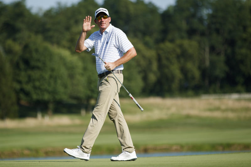 Jim Herman waves to the crowd after finishing on the 18th green during the third round of the Barbasol Championship golf tournament at Keene Trace Golf Club in Nicholasville, Ky., Saturday, July 20, 2019. (Alex Slitz/Lexington Herald-Leader via AP)
