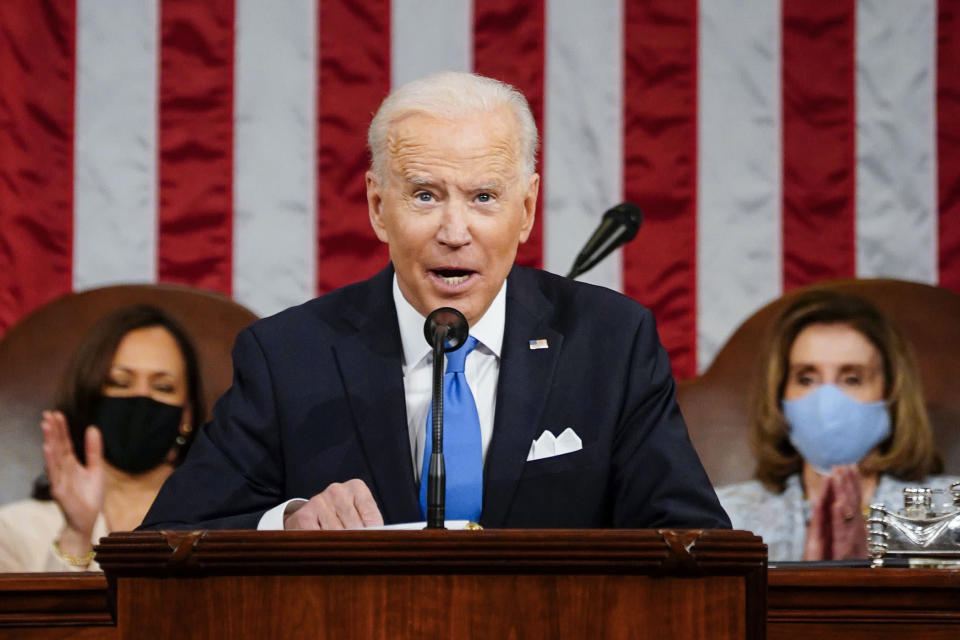 President Joe Biden addresses a joint session of Congress, Wednesday, April 28, 2021, in the House Chamber at the U.S. Capitol in Washington, as Vice President Kamala Harris, left, and House Speaker Nancy Pelosi of Calif., applaud. (Melina Mara/The Washington Post via AP, Pool)