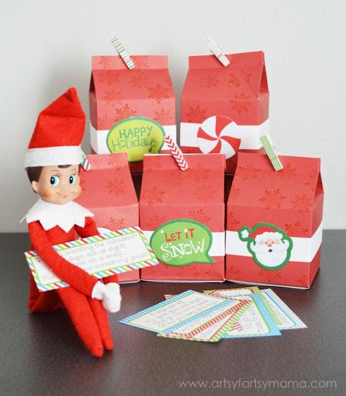 """<p>You don't have to help your Elf around the house every morning. Instead, he can stay put—but hold up a clue revealing a different gift each day.</p><p><strong>Get the tutorial at <a href=""""https://www.artsyfartsymama.com/2014/11/elf-on-shelf-advent.html"""" rel=""""nofollow noopener"""" target=""""_blank"""" data-ylk=""""slk:Artsy Fartsy Mama"""" class=""""link rapid-noclick-resp"""">Artsy Fartsy Mama</a>.</strong> </p>"""