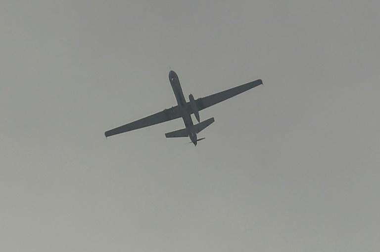 A drone flies over Kabul airport on August 31, the day US forces completed their withdrawal from Afghanistan (AFP/Aamir QURESHI)