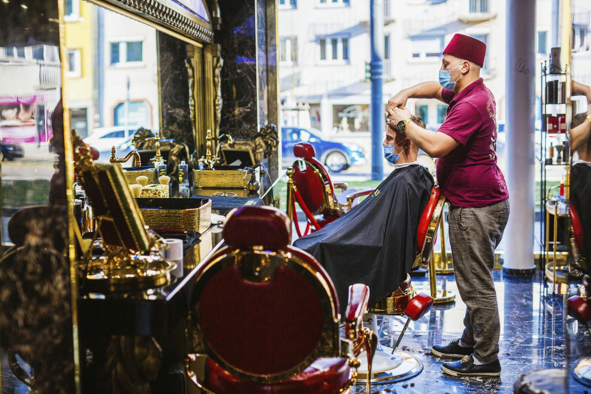 Germany reopens hairdressers, considers way ahead on virus