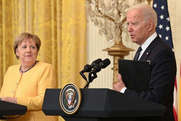 PHOTO: President Joe Biden and German Chancellor Angela Merkel hold a joint press conference in the East Room of the White House, July 15, 2021. (Saul Loeb/AFP via Getty Images)