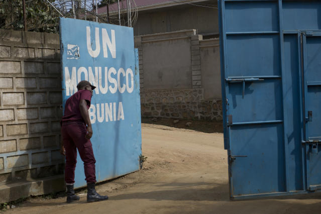 FILE - In this Aug.11, 2016, file photo, a security guard closes the gate of the UN compound in the Congo Ituri province capital Bunia. One by one, African leaders brought their world to U.N. headquarters. They told stories of illiteracy and malnutrition, about people living with HIV and without electricity. The dance the African leaders must perform at the U.N. General Assembly is delicate. (AP Photo/Jerome Delay, File)
