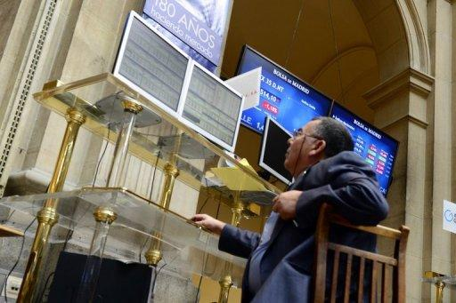 A trader looks at the IBEX-35 index billboard on Monday at Madrid's stock exchange. European leaders face difficult decisions in the days ahead on managing the outcome of the Greek election, upholding their credibility on financial discipline to avoid stoking contagion, and making convincing progress towards a grand plan for deeper integration.