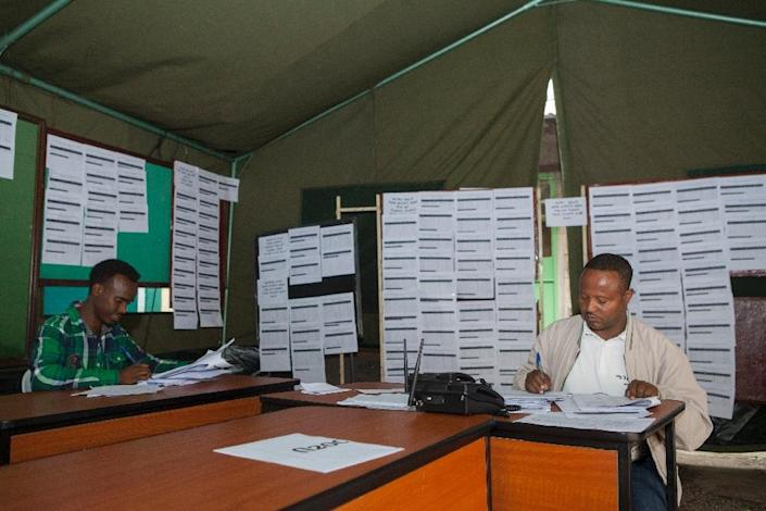 National Ethiopian Electoral Board employees tally votes from various regions at the National Ethiopian Electoral Board in Addis Ababa on May 27, 2015 (AFP Photo/Zacharias Abubeker)