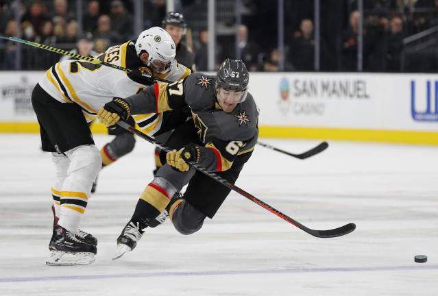 Boston Bruins right wing David Backes, left, checks Vegas Golden Knights left wing Max Pacioretty, right, to the ice during the second period of an NHL hockey game Wednesday, Feb. 20, 2019, in Las Vegas. (AP Photo/John Locher)