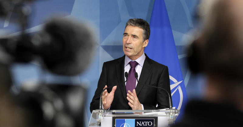 NATO Secretary General Anders Fogh Rasmussen addresses the media at NATO headquarters in Brussels on Wednesday, April 18, 2012. The United States and its NATO allies are readying plans to pull away from the front lines in Afghanistan next year as President Barack Obama and fellow leaders try to show that the unpopular war is ending. (AP Photo/Virginia Mayo)