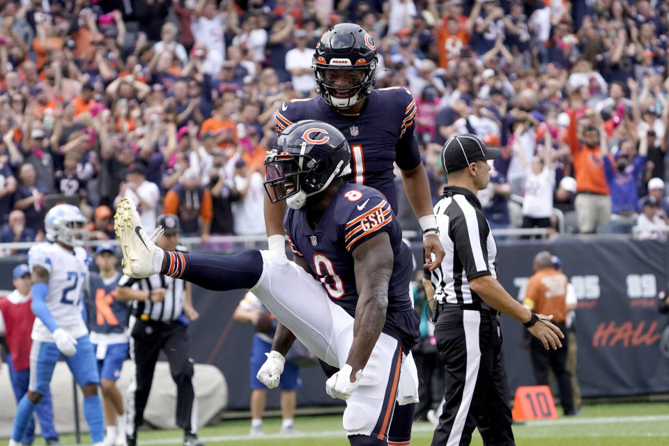 Chicago Bears running back Damien Williams (8) celebrates his touchdown with quarterback Justin Fields during the second half of an NFL football game against the Detroit Lions Sunday, Oct. 3, 2021, in Chicago. (AP Photo/David Banks)
