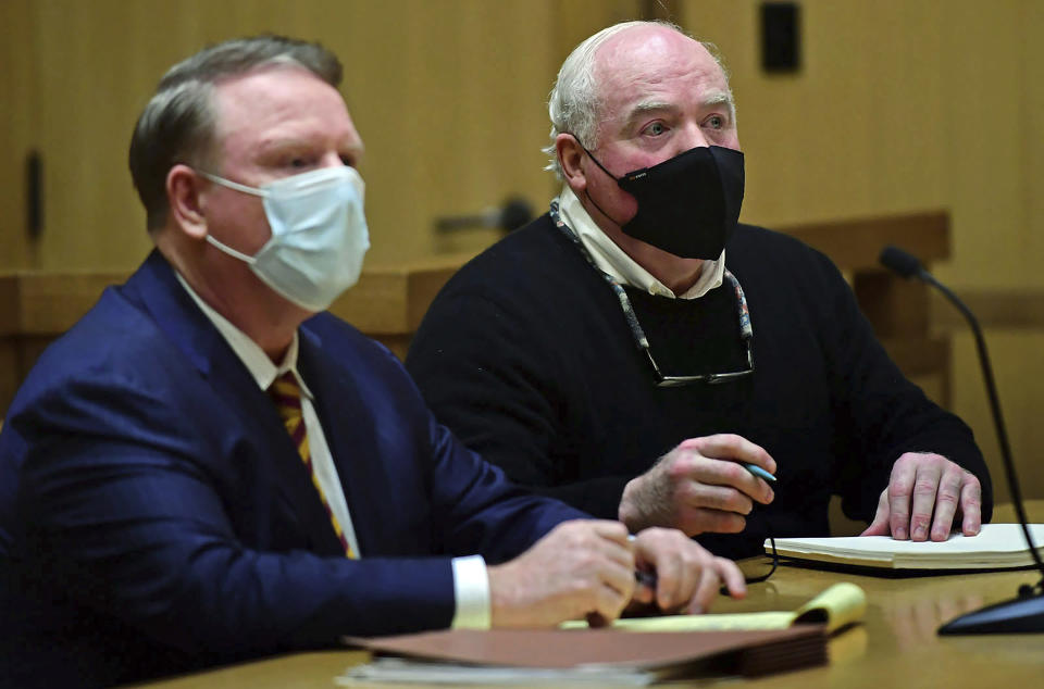 Michael Skakel, right, appears for his hearing at Stamford Superior Court, with his attorney Stephan Seeger, Friday, Oct. 30, 2020, in Stamford, Conn. A Connecticut prosecutor says Kennedy cousin Michael Skakel will not face a second trial in the 1975 murder of teenager Martha Moxley in Greenwich. (Erik Trautmann/Hearst Connecticut Media via AP, Pool)