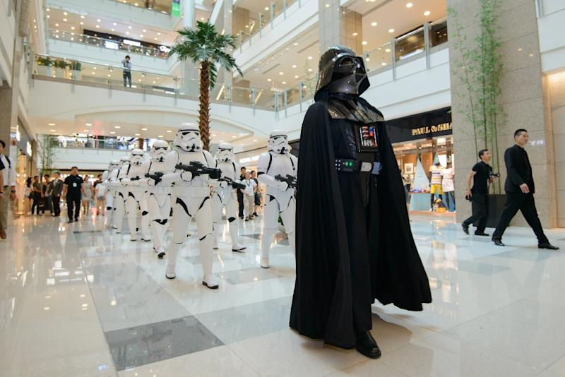 Darth Vader (centre) marches with Storm Troopers during a Star Wars movie event in Shanghai on June 14, 2015 (AFP Photo/Walt Disney Studios China)