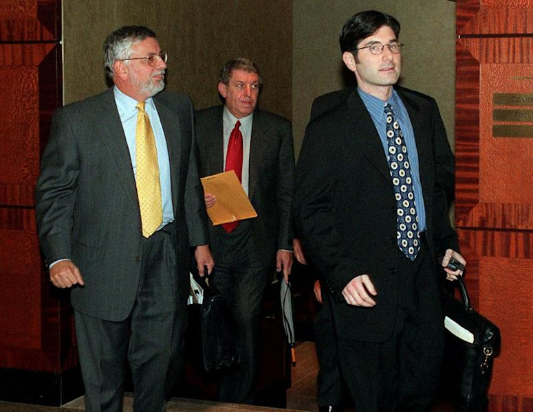 FILE - In this Oct. 13, 1998, file photo, from left, NBA Commissioner David Stern, Phoenix Suns owner Jerry Colangelo, and chief legal counsel Jeffrey Pollack, leave a meeting between owners and players in New York during the lockout. He is not in the Hall of Fame, he never played in an All-Star game and he is about a foot shorter than most NBA stars. But try to find an NBA legacy more lasting than Stern's, who is retiring Saturday, Feb. 1, 2014 after exactly 30 years on the job. (AP Photo/Ed Bailey, File)