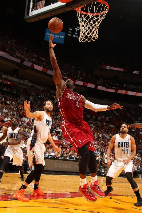 Wade active for Heat, Beasley out
