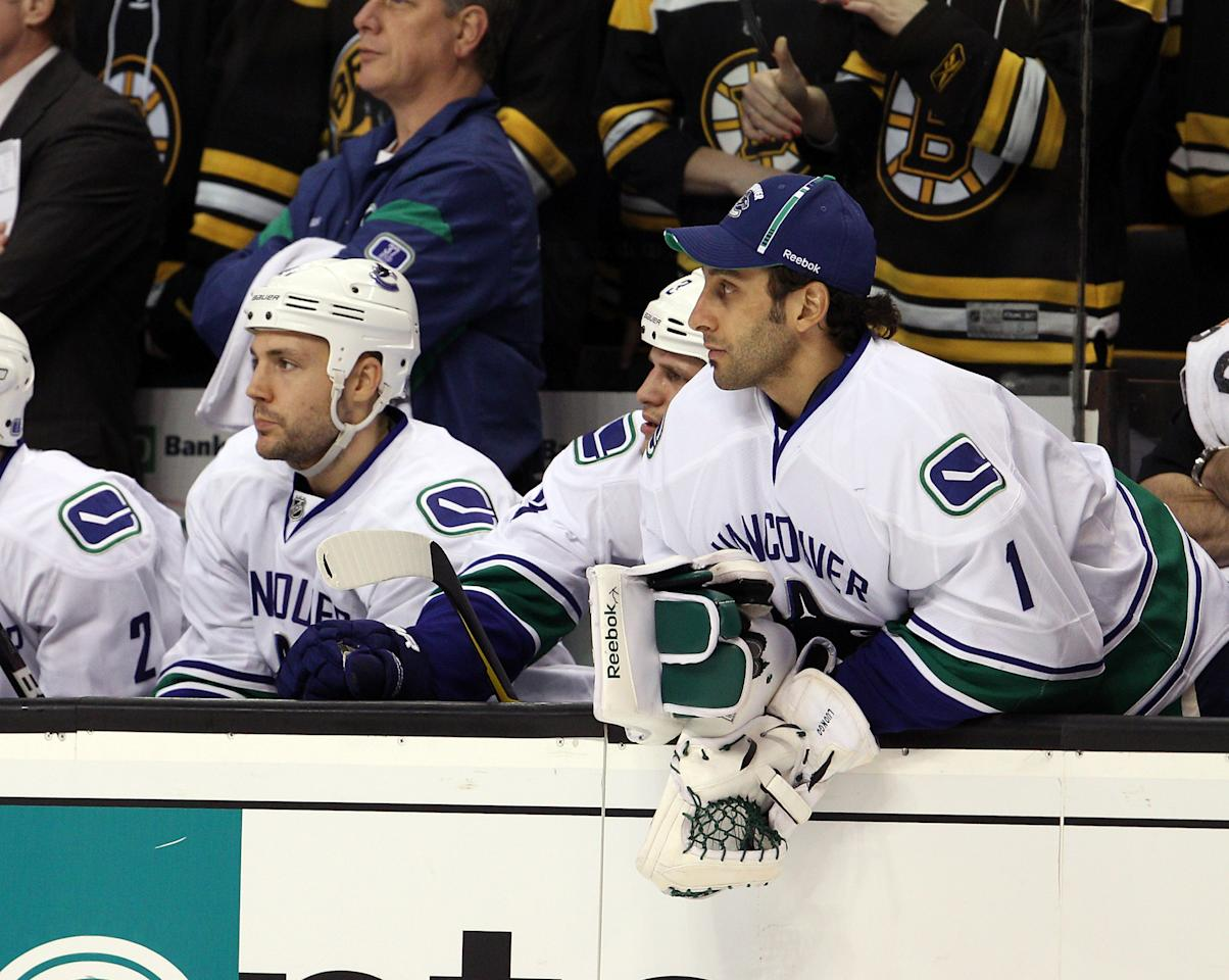 BOSTON, MA - JANUARY 07: Roberto Luongo #1 of the Vancouver Canucks looks on from the bench in the first period against the Boston Bruins on January 7, 2012 at TD Garden in Boston, Massachusetts.  (Photo by Elsa/Getty Images)