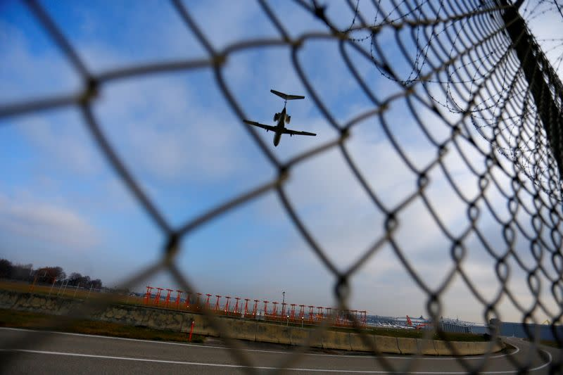 FILE PHOTO: An airplane prepares to land at Cointrin airport in Geneva
