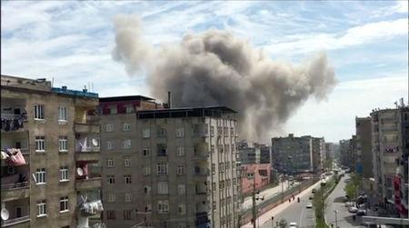 Smoke is seen coming out from a building after an explosion in Diyarbakir, Turkey in this still frame taken from video