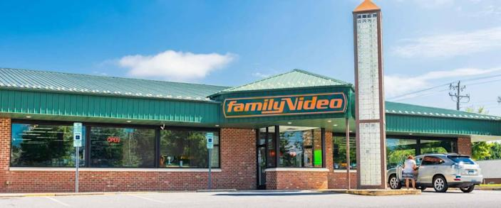 HICKORY, NC, USA-9/2/18: A Family Video store, one in the only chain of video stores in the U.S., with one car and one female in parking lot.