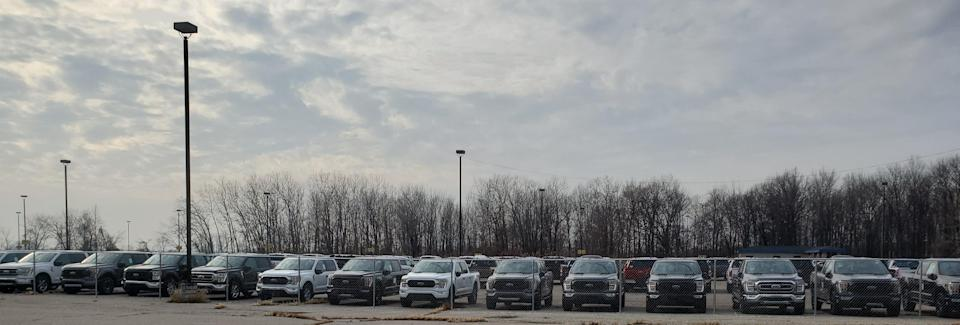 2021 Ford F-150 pickup trucks fill private parking lots around Detroit Metro Airport. This image was taken on December 11, 2020.
