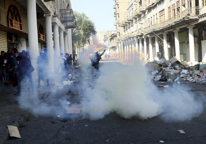 Riot police fire tear gas while blocking al-Rashid Street during clashes with anti-government demonstrators in Baghdad, Iraq, Nov. 22, 2019. (Photo: Hadi Mizban/AP)