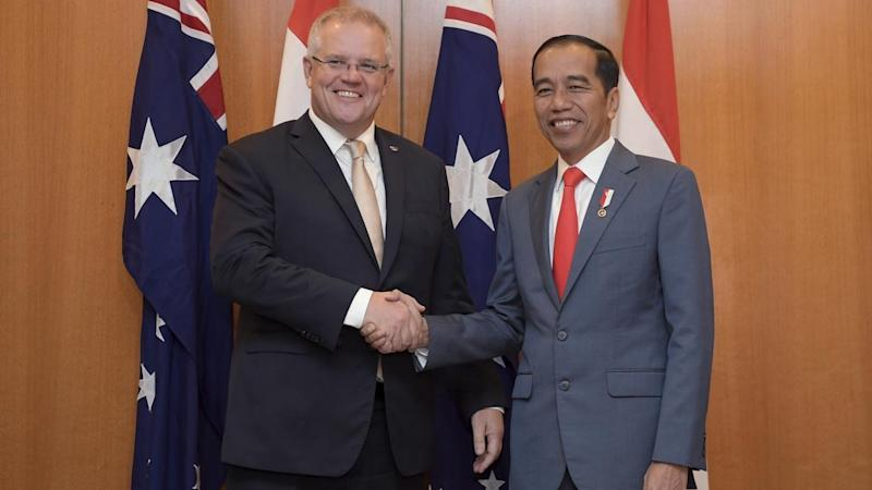 Indonesian President Joko Widodo (R) has signed-off on a lucrative trade agreement with Australia