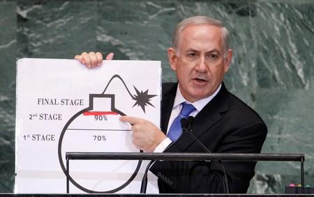 FILE PHOTO: Israel's Prime Minister Netanyahu points to red line he has drawn on graphic of bomb as he addresses 67th United Nations General Assembly in New York