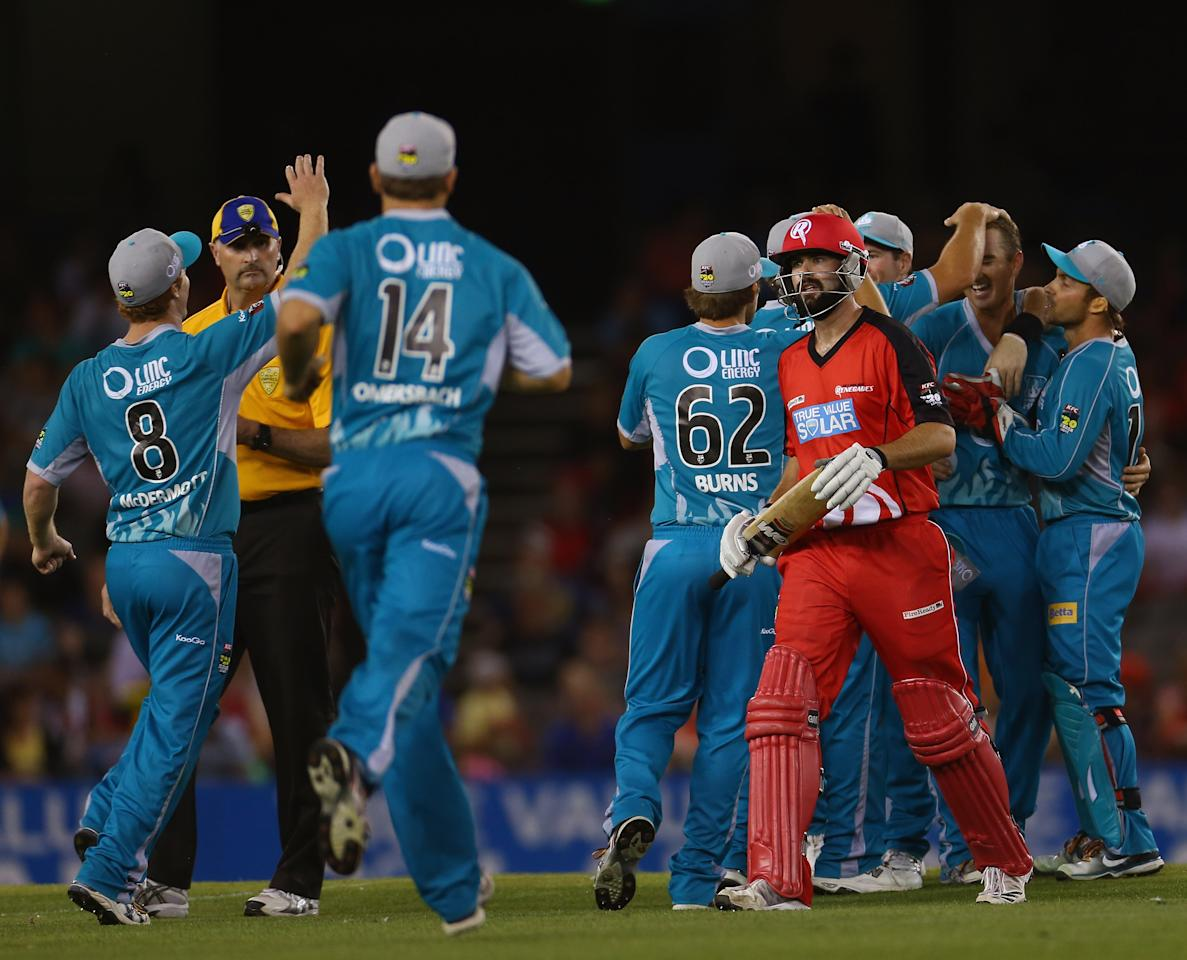 MELBOURNE, AUSTRALIA - JANUARY 15: Alex Doolan of the Renegades walks from the ground after he was dismissed during the Big Bash League Semi-Final match between the Melbourne Renegades and the Brisbane Heat at Etihad Stadium on January 15, 2013 in Melbourne, Australia.  (Photo by Robert Cianflone/Getty Images)