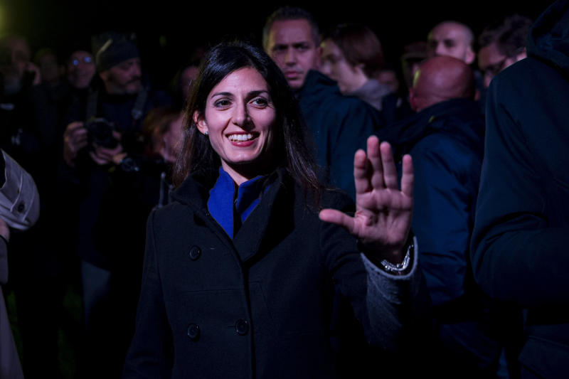 ROME, ITALY - NOVEMBER 20: Rome Mayor Virginia Raggi and President of the parliamentary anti-mafia commission Nicola Morra take part in the torchlight to remember the demolition of the villas of Casamonica criminal clan, on November 20, 2019 in Rome, Italy. On November 20, 2018 the authorities in Rome demolished eight illegally built villas belonging to members of the Casamonica criminal clan. The operation involved 600 municipal police with the presence of Mayor Virginia Raggi. (Photo by Antonio Masiello/Getty Images)