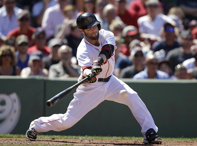 Boston Red Sox's Dustin Pedroia grounds into a fielder's choice allowing Jackie Bradley Jr. to score in the fifth inning of a baseball game against the Cleveland Indians, Sunday, June 15, 2014, in Boston. (AP Photo/Steven Senne)