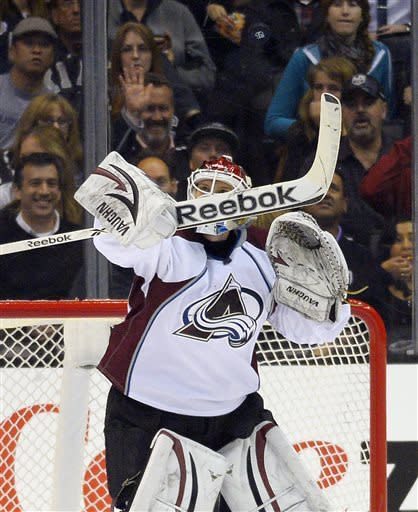 Colorado Avalanche goalie Sami Aittokallio, of Finland, deflects a shot during the first period of their NHL hockey game against the Los Angeles Kings, Thursday, April 11, 2013, in Los Angeles. (AP Photo/Mark J. Terrill)