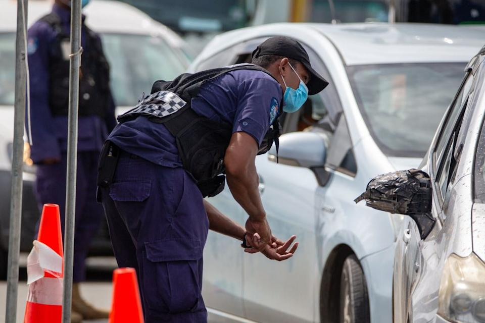 Security officers man a checkpoint at a junction in the Fijian capital Suva.