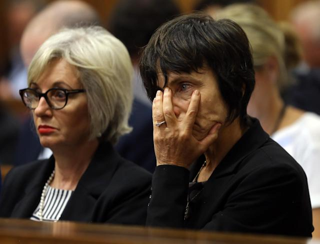 The aunt of Oscar Pistorius, Lois Pistorius, left, and an unidentified relative, right, listen to forensic evidence during the trial of Oscar Pistorius in court in Pretoria, South Africa, Thursday March 13, 2014. Pistorius is charged with the shooting death of his girlfriend Reeva Steenkamp, on Valentines Day in 2013. (AP Photo/Themba Hadebe, Pool)
