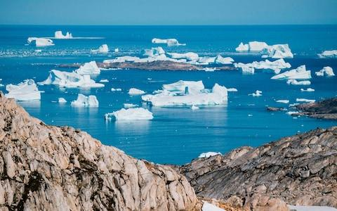 <span>Huge amount of ice is melting in Greenland due to climate change</span> <span>Credit: Jonathan Nackstrand/AFP </span>