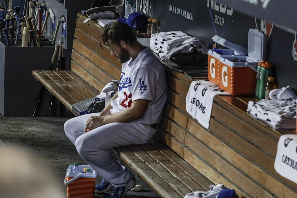 Dodgers pitcher Clayton Kershaw sits in the dugout during the Dodgers' Game 5 loss.