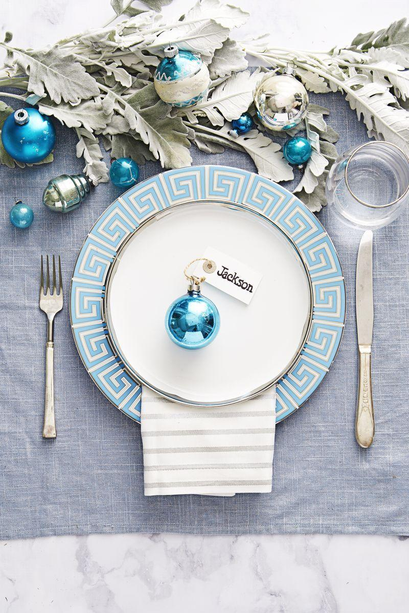 <p>Try an icy blue and silver color palette. For the name card, tie a store-bought tag to a metallic glass ornament.</p>