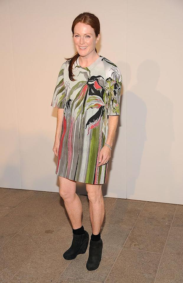 """Following in Ms. Meester's footsteps was the typically glam Julianne Moore, who must have been vision-impaired when she paired this painful print dress with clunky black booties <i>and</i> black socks. Gary Gershoff/<a href=""""http://www.wireimage.com"""" target=""""new"""">WireImage.com</a> - September 7, 2010"""